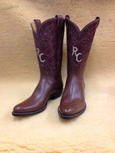 "Medium brown softy water buffalo with 12"" bergundy tops, single row of stitching and initials inlaid in the tops"