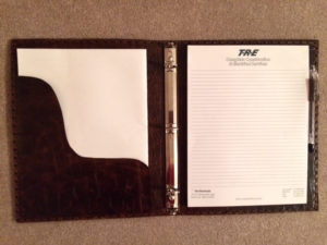 leather notebook and three ring binder