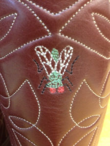 A fly sewn into boot tops