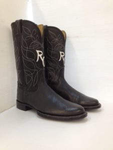 Black softy water buffalo ropers with a single row of top stitching and initials inlaid in the fronts
