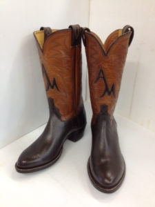 Dark brown softy water buffalo with two rows of top stitching and initials inlaid in the fronts